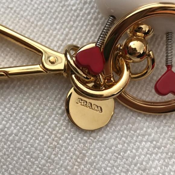 fb3484c56100 Prada Cupido Saffiano Leather Keychain Trick. M_5ae5f10d8df4700b3a63fbf4